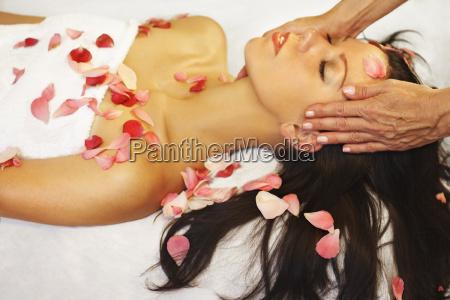 woman enjoying aromatherapy and massage