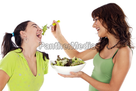 two beautiful girls with a salad