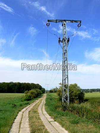 electricity pylon next to concrete slab
