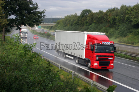 truck on three lane highway near