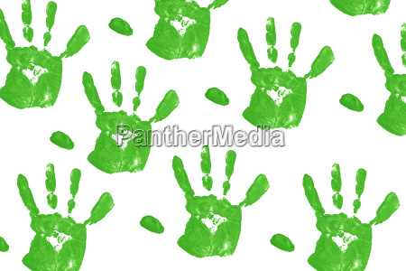 close up green child handprints on