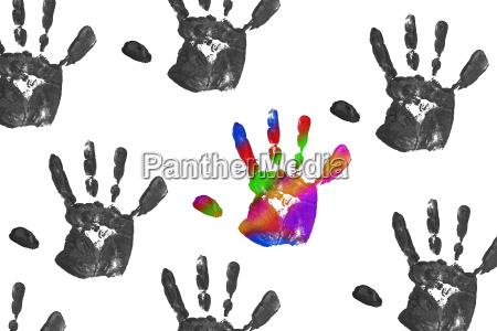 close up colorful child handprints