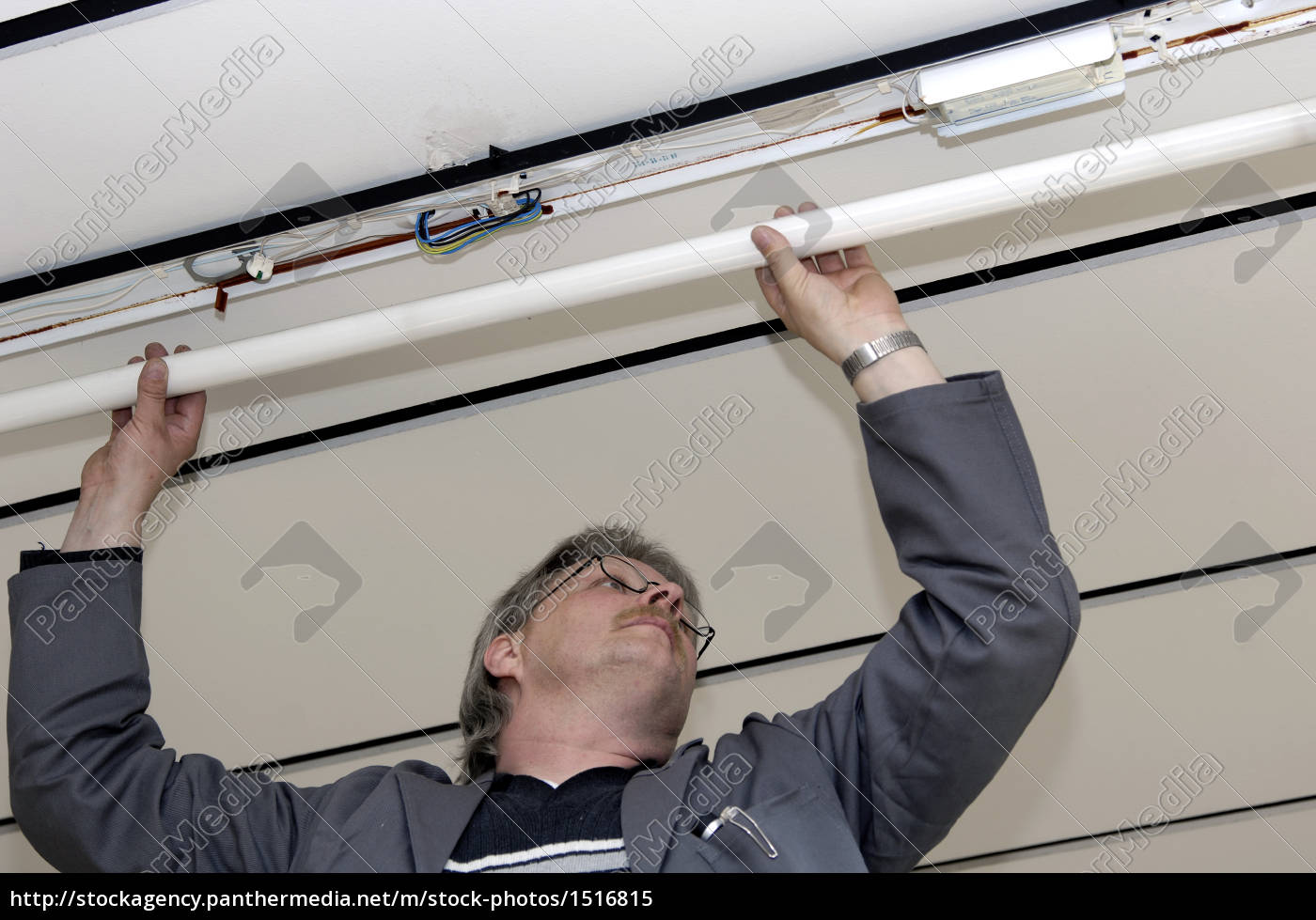 electrician, repairing, a, ceiling, light - 1516815