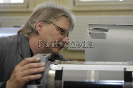 technicians waiting a copier