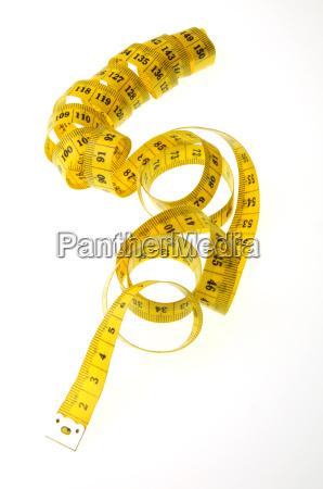 yellow measuring tape as spiral free
