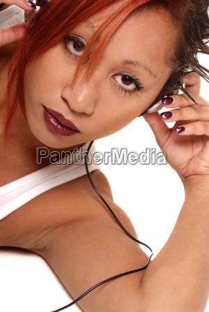 woman finger music listen hold earphones