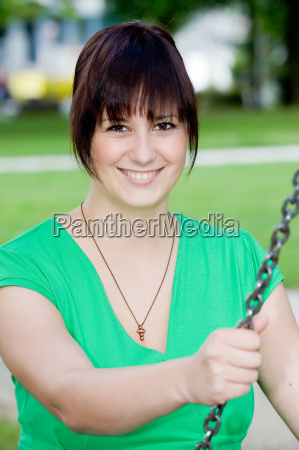 young woman in the swing