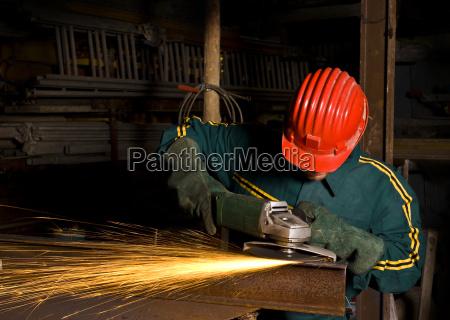 , worker, with, grinder - 1563427
