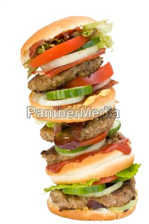 quadruple hamburger isolated on white