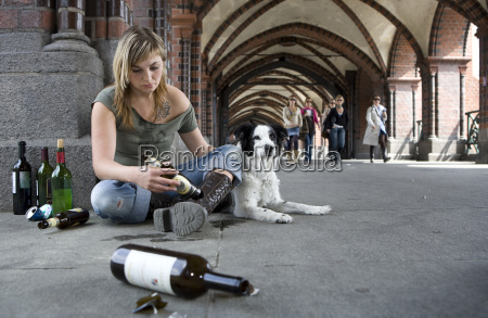 young, woman, with, dog, drinking, alcohol - 1604749