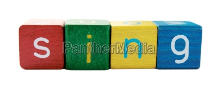 sing in colorful block letters