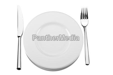 cutlery beside a plate