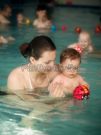 mama and baby in the swimming