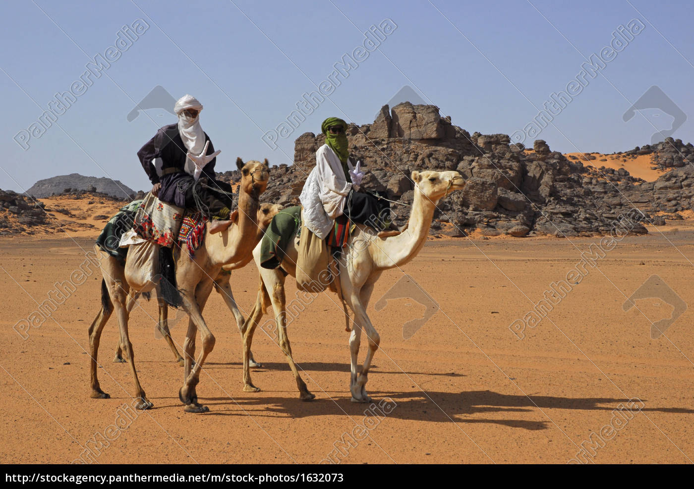 bedouins, on, camels, in, akakus, mountains - 1632073