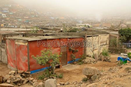 huts in slums lima