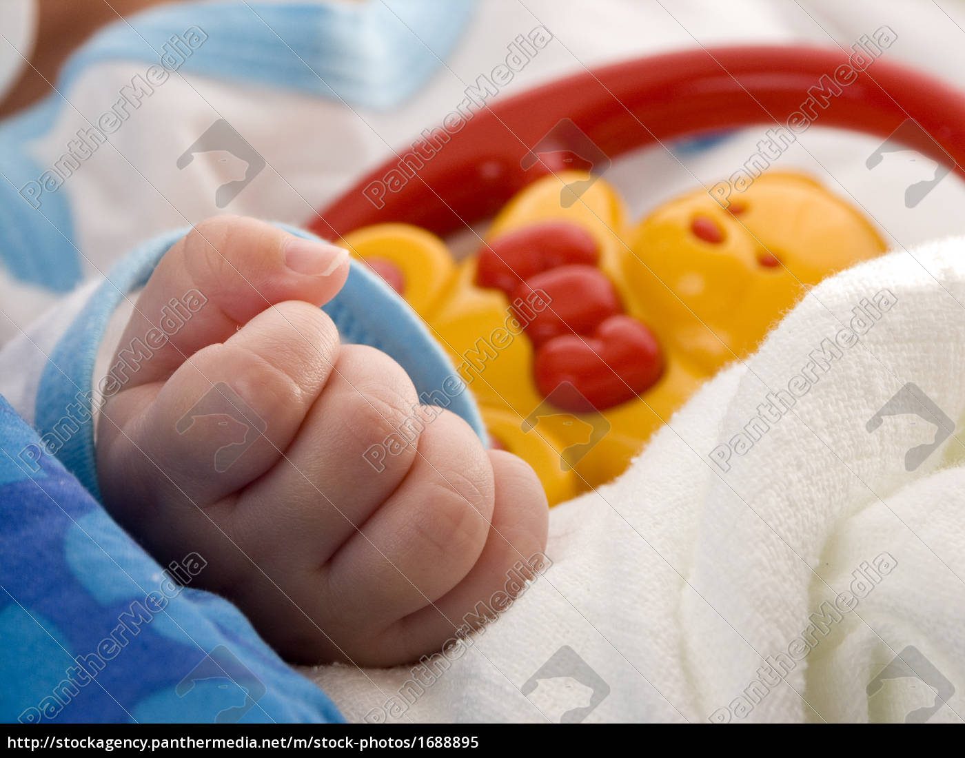 close-up, hand, with, baby, toy, - - 1688895