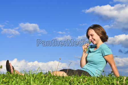 young, girl, sitting, on, grass - 1704221