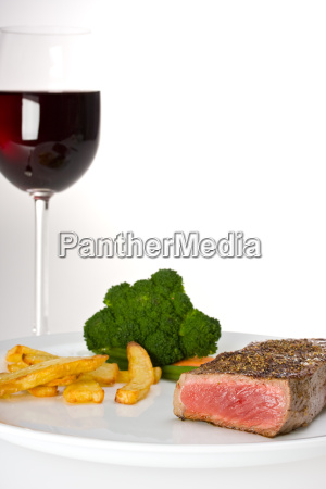 steakvegetables and a glass of red