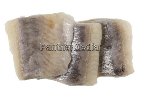 three slices of marinated herring
