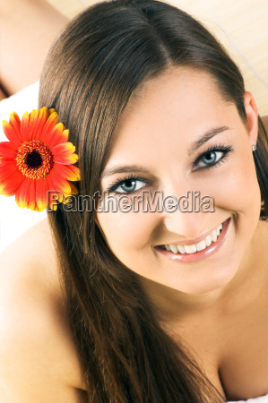 happy woman in wellness with flower