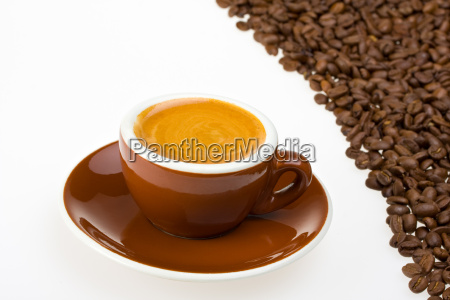 cup of espresso and espresso beans