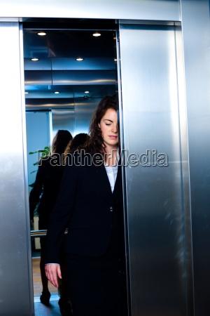 , , businesspeople, in, elevator - 1763647