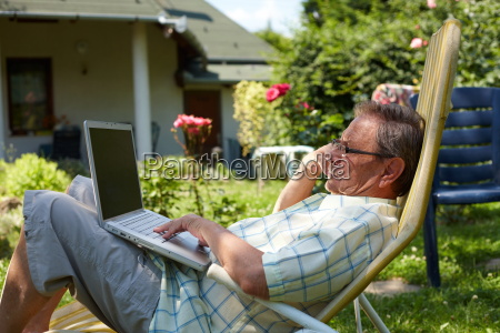 senior, man, using, laptop, outdoor - 1763415