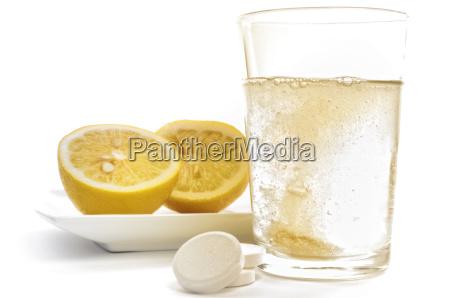 vitamin c effervescent tablet and lemons