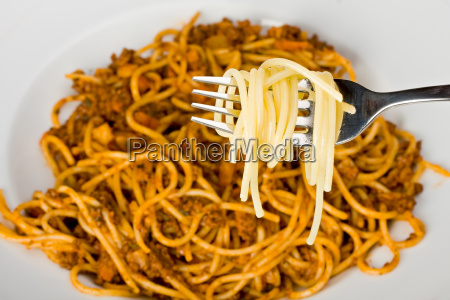 fork over a plate of spaghetti