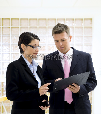 businesspeople looking at documents