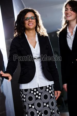 young businesswomen at office corridor