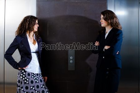 businesswomen waiting for elevator