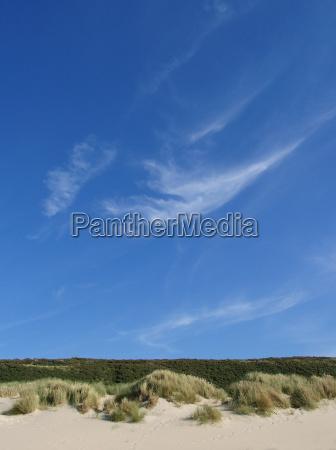 blue sky over dune landscape