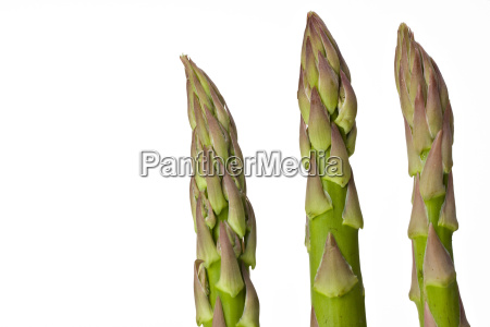 three fresh green asparagus spears isolated