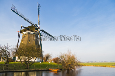 dutch landscape with windmill in winter