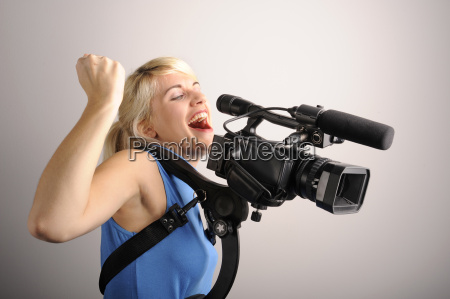 young woman video camera