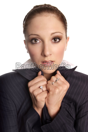 brunette woman wearing business suit cold