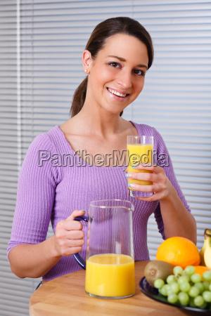 woman wants to drink orange juice