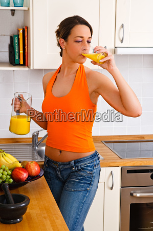 young woman drinking a glass of