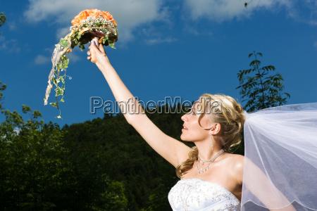 bride stretching bouquet