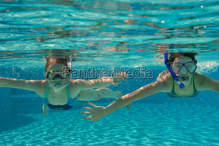 girl snorkeling in the pool