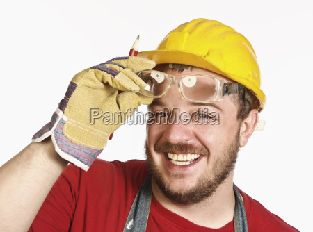 handyman with protection glass