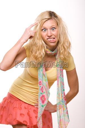 goofy blond girl wondering