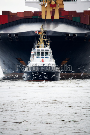 tugboat pulling freighter