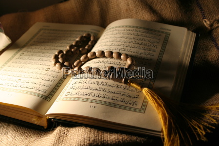 holy koran book with rosary