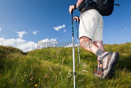 hiker walking along a mountain path
