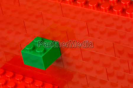 red building block wall with green