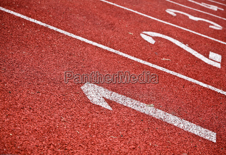 closeup of numbered running track lanes