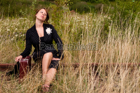woman sits on the tracks