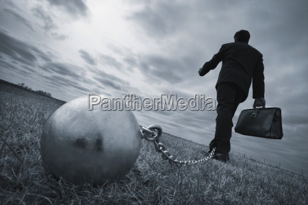 businessman with ball and chain